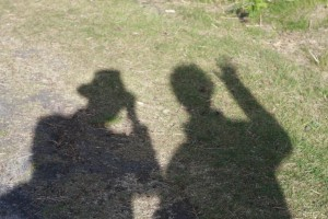 Shadows of me and my father in Thetford Forest